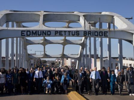"FILE - In this March 7, 2015, file photo, President Barack Obama, first lady Michelle Obama, their daughters Malia and Sasha, as well as members of Congress, former President George W. Bush, and civil rights leaders make a symbolic walk across the Edmund Pettus Bridge in Selma, Ala., on the 50th anniversary of ""Bloody Sunday,"" a civil rights march in which protestors were beaten, trampled and tear-gassed by police at the site. Blacks who celebrate the civil rights movement and whites who commemorate the Civil War are suddenly finding themselves fighting on the same side in historic Selma, Alabama: against City Hall. (AP Photo/Jacquelyn Martin, File)"