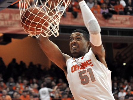 FILE - In this Jan. 14, 2012, file photo, Syracuse's Fab Melo dunks against Providence during an NCAA college basketball game in Syracuse, N.Y. Military police said that former Syracuse and Celtics center Melo died in his native Brazil. A police sergeant said an emergency call Saturday, Feb. 11, 2017 brought police and paramedics to Melo's house, but that when the police arrived, paramedics said Melo was dead. (AP Photo/Kevin Rivoli, File)
