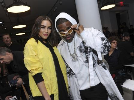 Olivia Culpo, left, and ASAP Ferg attend the Public School runway show during Fashion Week in New York, Sunday, Feb. 12, 2017. (AP Photo/Diane Bondareff)