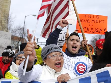 Protesters participate in a march aimed squarely at President Donald Trump's efforts to crack down on immigration Thursday, Feb. 16, 2017, in Chicago. Immigrants around the country have been staying home from work and school today, hoping to demonstrate their importance to America's economy and its way of life. (AP Photo/Charles Rex Arbogast)