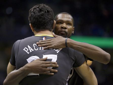 FILE - In this Nov. 19, 2016, file photo, Golden State Warriors' Kevin Durant hugs Zaza Pachulia after the team's NBA basketball game against the Milwaukee Bucks in Milwaukee. With all that was made before the season about adding Kevin Durant to an already star-studded roster, Golden State's players have jelled just fine. (AP Photo/Aaron Gash, File)