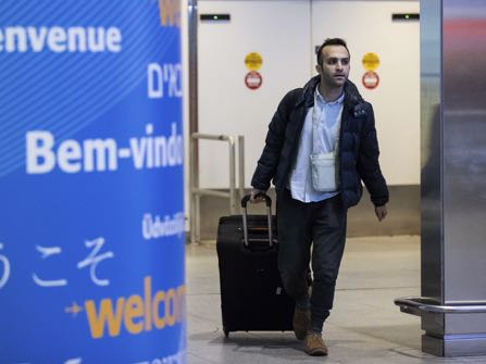 Iranian-born bioengineer researcher Nima Enayati walks out of an entrance after arrival at John F. Kennedy International Airport in New York, Sunday, Feb. 5, 2017. Just hours after an appeals court blocked an attempt to re-impose the travel ban, Iranian researcher Nima Enayati checked in on an Emirates Airline flight direct from Milan's Malpensa airport to New York's JFK on Sunday afternoon. (AP Photo/Alexander F. Yuan)