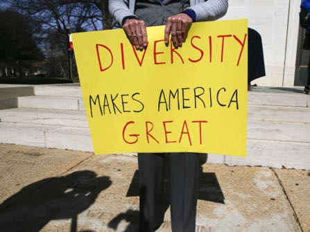 Professor Fran O'Neal holds a sign during a gathering at the University of Alabama in Tuscaloosa, Ala., to support an open campus and oppose the travel ban imposed by President Donald Trump Thursday, Feb.9, 2017. (AP Photo/Gary Cosby Jr., Tuscaloosa News) (Gary Cosby Jr./The Tuscaloosa News via AP)