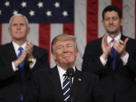 Vice President Mike Pence (L) and Speaker of the House Paul Ryan (R) applaud as US President Donald J. Trump (C) delivers his first address to a joint session of Congress from the floor of the House of Representatives in Washington, DC, USA, 28 February 2017. Traditionally the first address to a joint session of Congress by a newly-elected president is not referred to as a State of the Union.