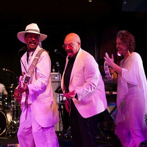 Tom gets down with Larry Graham.