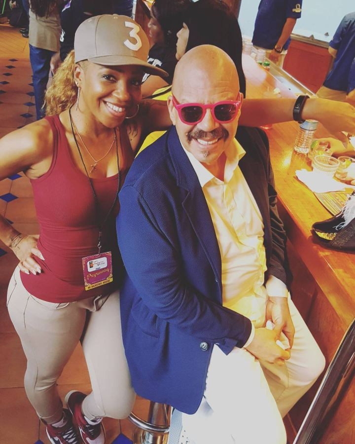 Tom Joyner with his goddaughter.