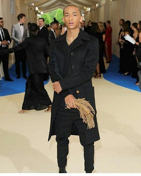 Jaden Smith and yes, those are his locs in his hand…