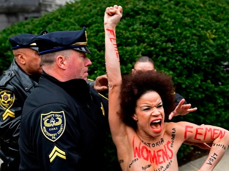 Topless Protester Charges At Bill Cosby As Retrial Begins