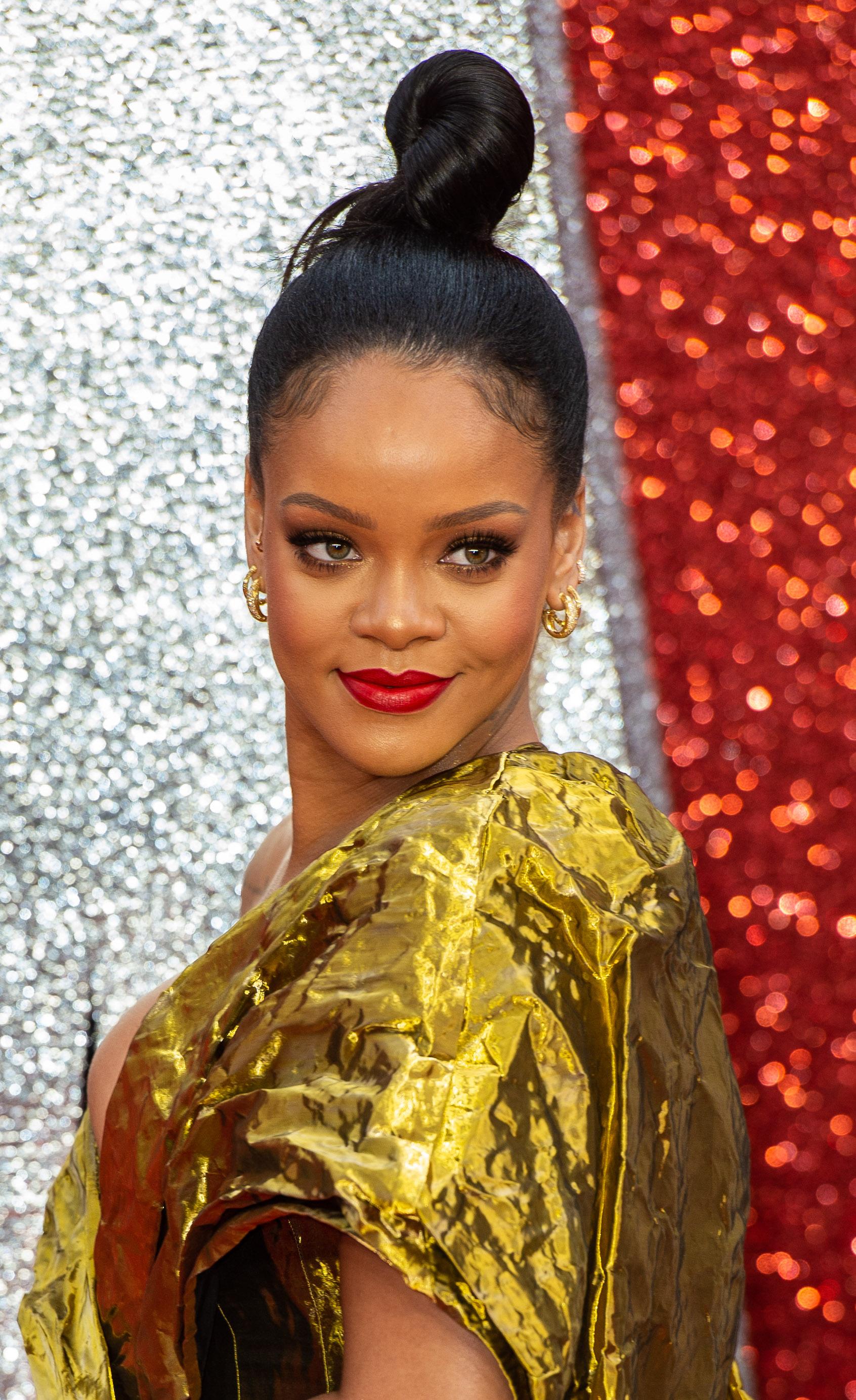 Rihanna Sued By Clothing Company Over 'FU' Logo